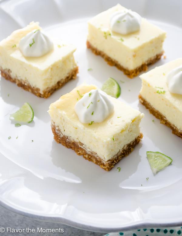 Key lime cheesecake bars on a pedestal server