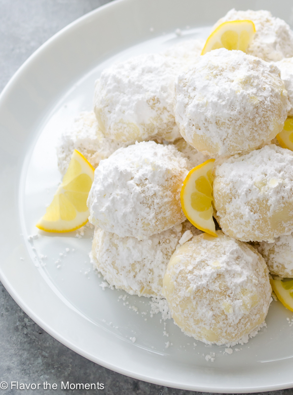 close up of meyer lemon greek butter cookies kourabiedes piled on top of each other