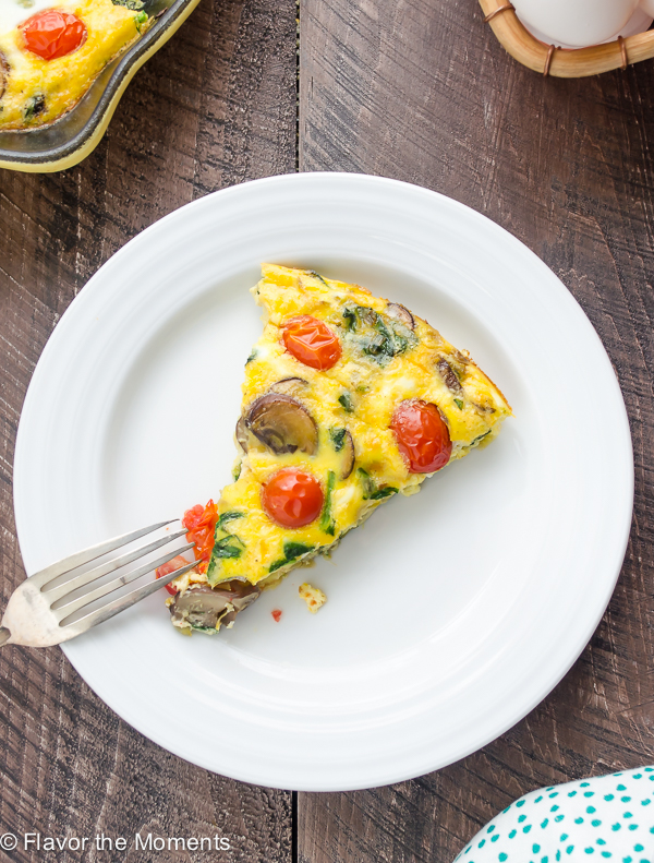 Skillet Crustless Quiche on a white plate with fork