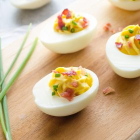 Bacon Chive Deviled Eggs are creamy deviled eggs topped with freshly chopped chives and crumbled bacon. They're perfect for leftover hard boiled eggs and entertaining! @FlavortheMoment