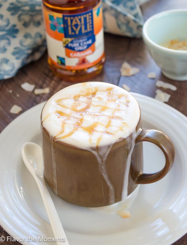 coconut milk macchiato in brown mug with caramel drizzle