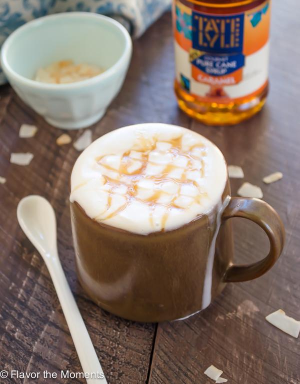 close up shot of coconut milk macchiato in brown mug with caramel drizzle