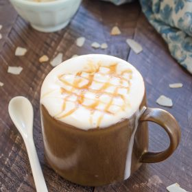 Dairy free macchiato in mug with caramel syrup on top