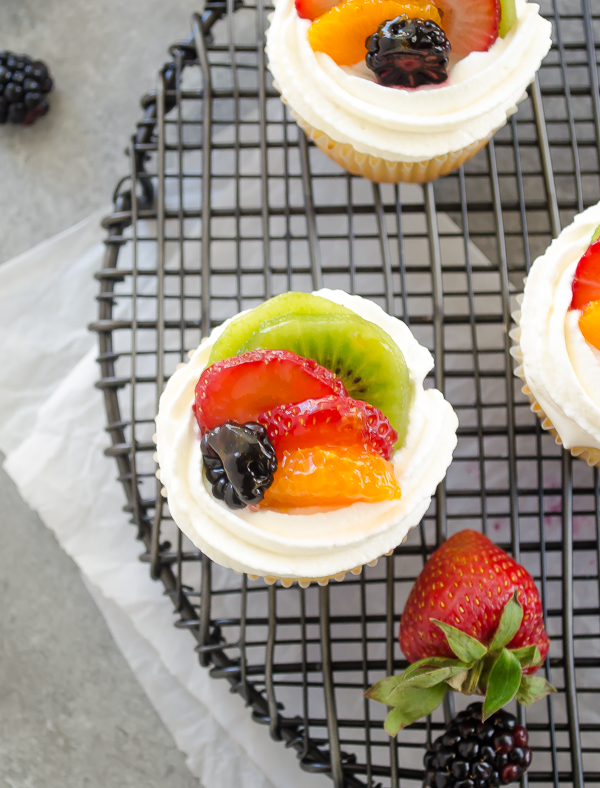 Fruit tart vanilla cupcakes on wire rack