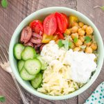 Greek Orzo Pasta Salad Bowls with Mediterrean Roasted Chickpeas are orzo pasta topped with plenty of mediterranean veggies, roasted chickpeas, and tzatziki sauce! @FlavortheMoment