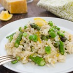Spring Vegetable Lemon Risotto is creamy risotto packed with spring veggies, fresh lemon flavor, and grated parmesan. It's an easy meatless meal! @FlavortheMoment