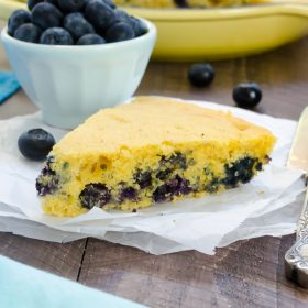 Blueberry Maple Skillet Cornbread is a healthier take on cornbread sweetened with maple syrup and studded with fresh blueberries! @FlavortheMoment