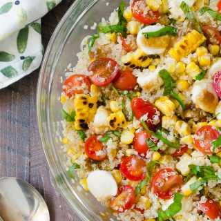Grilled Corn Caprese Quinoa Salad merges grilled corn and caprese flavors into summer's best quinoa salad! @Flavorthemoment