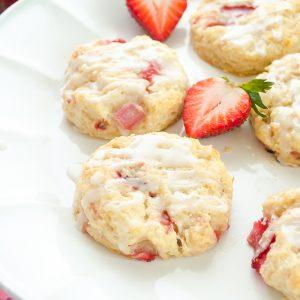 close up of strawberry scones on white pedestal server