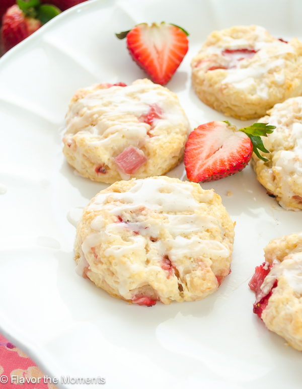 Mini Glazed Strawberry Scones are tangy buttermilk scones bursting with fresh strawberries and topped with a luscious vanilla bean glaze! @FlavortheMoment