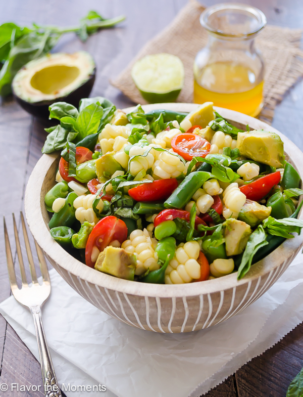 Summer succotash salad in bowl with fork