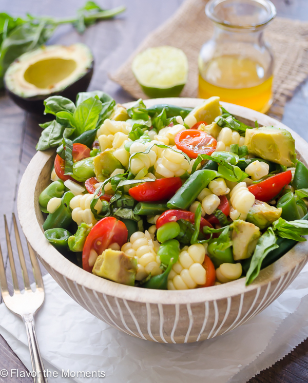 Summer Succotash Salad with Tangy Lime Vinaigrette is a medley of summer produce tossed with fresh basil and a fresh lime vinaigrette! @FlavortheMoment