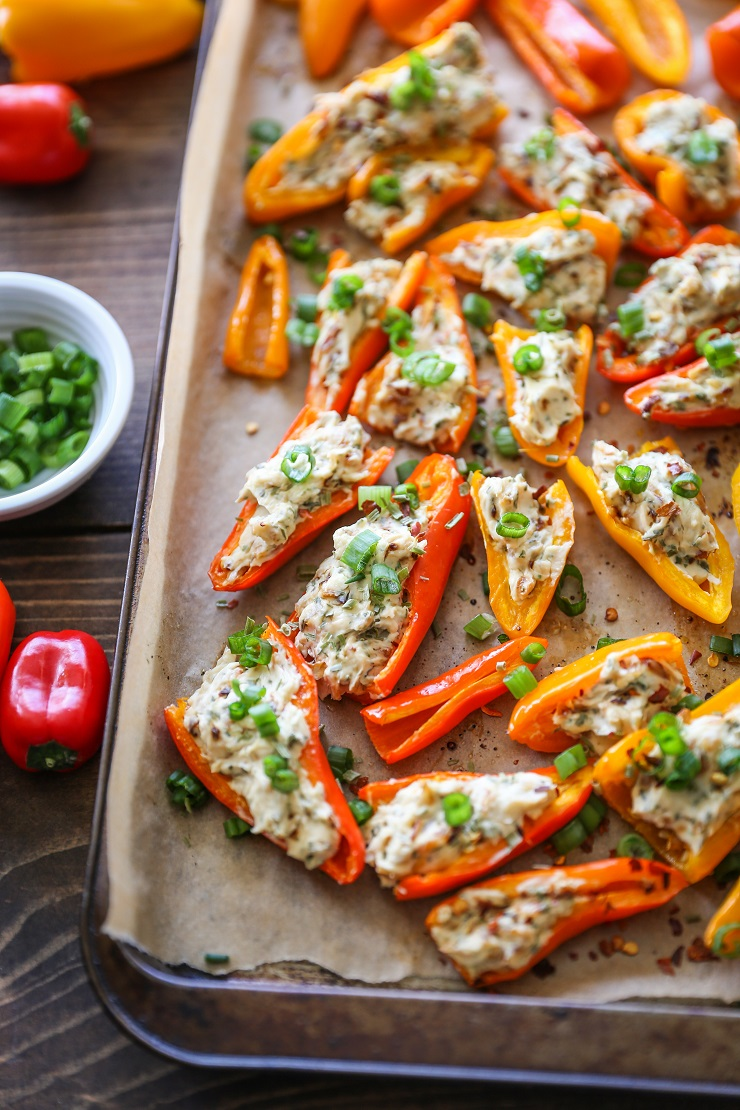 caramelized onion and cream cheese stuffed peppers on baking sheet