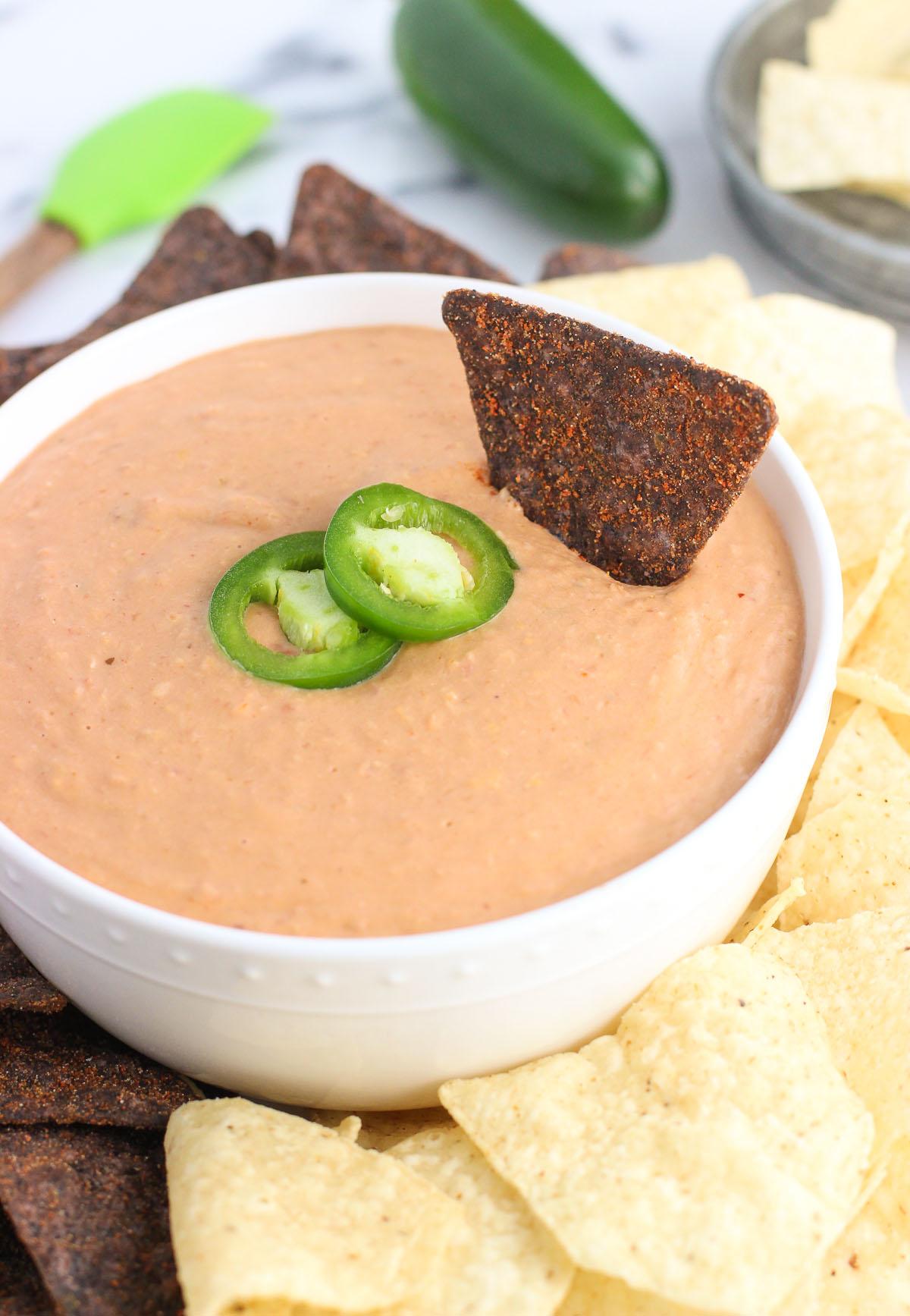 Cheesy salsa bean dip in bowl