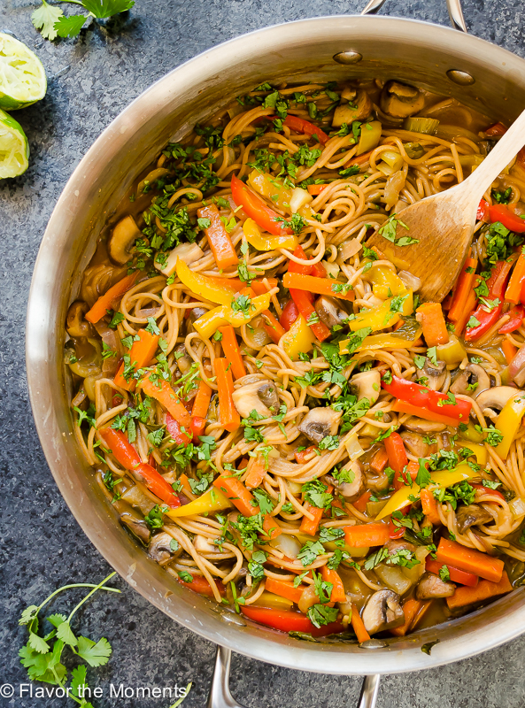 Thai peanut pasta in skillet with wooden spoon