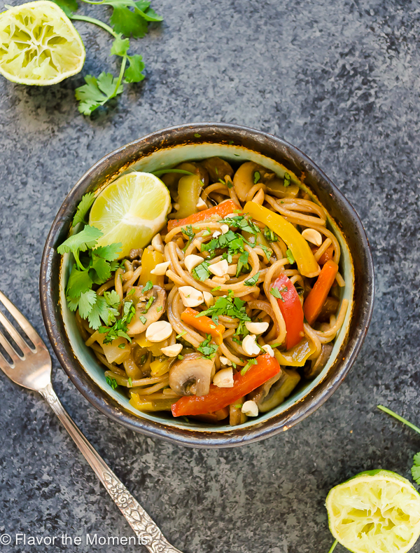 One Pot Thai Peanut Veggie Pasta is whole wheat spaghetti and plenty of veggies in a flavorful Thai peanut sauce. It's a delicious meatless meal that's on the table in 30 minutes! @FlavortheMoment