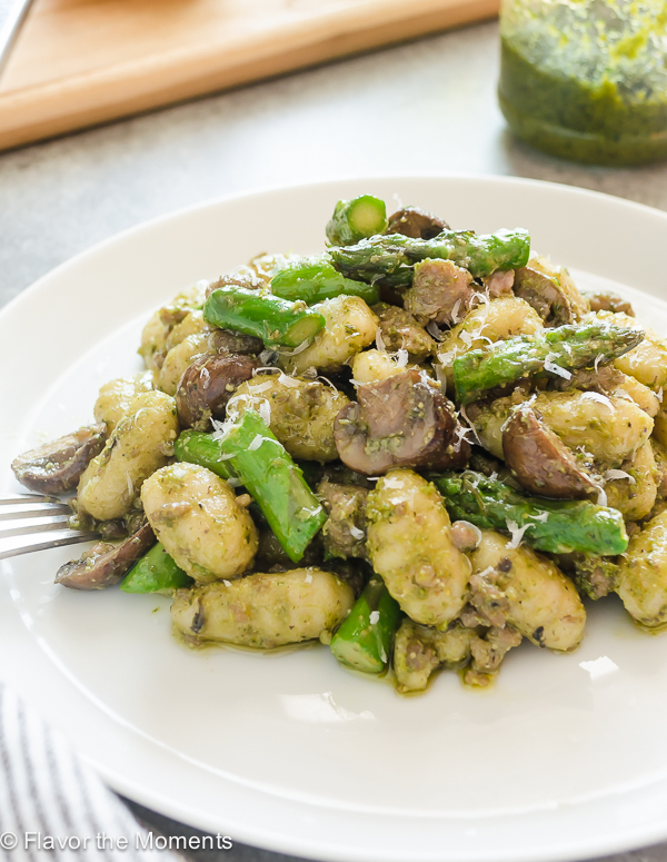 Pesto Gnocchi on a white plate with fork