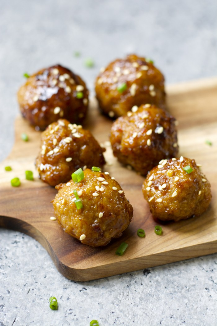 Asian meatballs on a cutting board