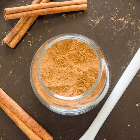 Homemade chai spice in jar with cinnamon sticks and spoon