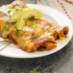 sweet potato enchiladas on a plate close up
