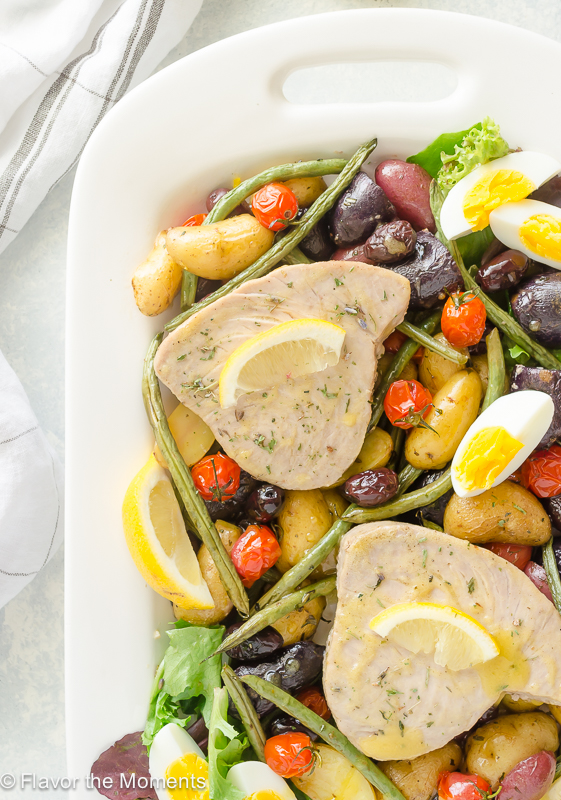 30 Minute Sheet Pan Tuna Nicoise is classic tuna nicoise salad in sheet pan form! It's a 30 minute one pot meal that's perfect for busy weeknights and even entertaining! @FlavortheMoment