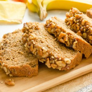 close up of sliced banana nut bread on cutting board