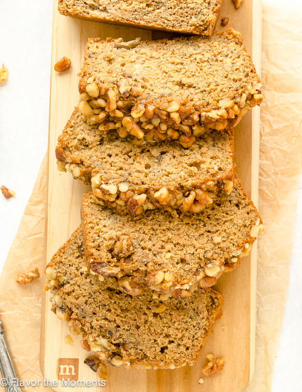 sliced banana nut bread on wooden cutting board