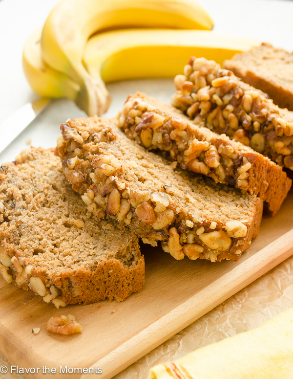 close up of banana nut bread slice with walnuts on top