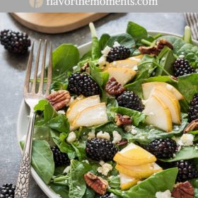 close up of power greens salad with pears and blackberries