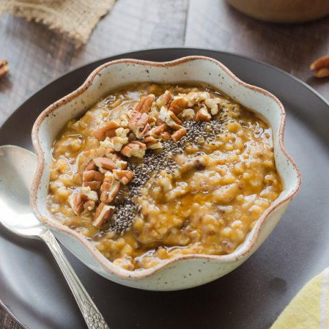 Pumpkin Steel Cut Oats in a bowl with chia seeds and pecans on top