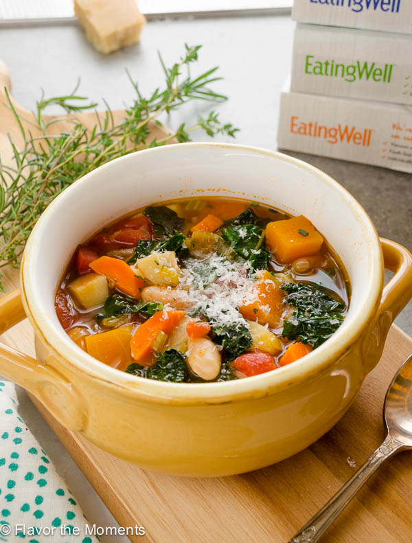 Autumn vegetable soup topped with parmesan cheese