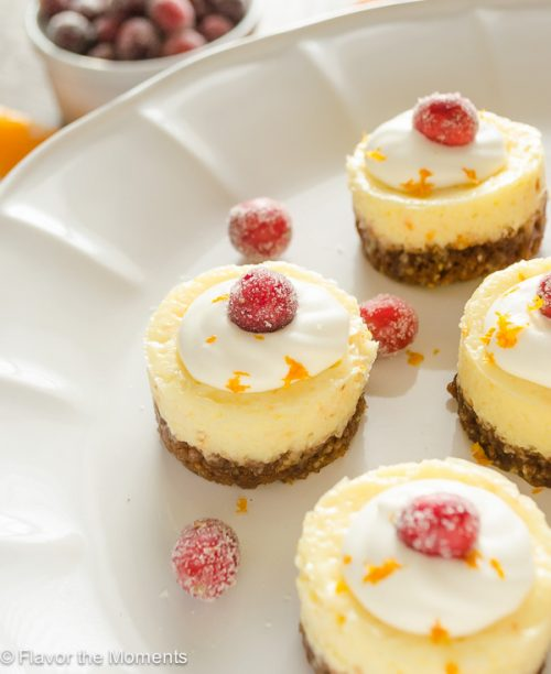 Mini Cranberry Orange Cheesecakes with Gingersnap Crust are creamy bite-sized cheesecakes bursting with holiday flavor! @FlavortheMoment