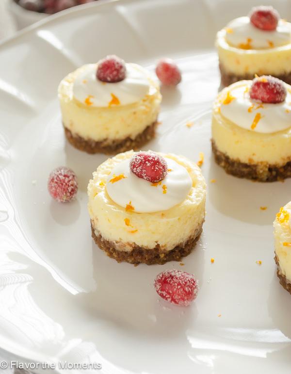 mini cranberry orange cheesecakes on white pedestal server