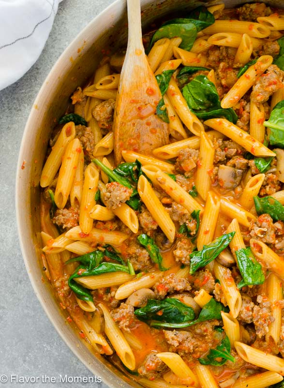 Creamy sausage red pepper pasta in skillet