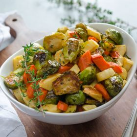 Maple Thyme Roasted Brussels Sprouts, Carrots, and Parsnips are crisp, caramelized roasted veggies with fresh thyme and maple flavor. Serve these, and nobody will complain about eating their veggies! @FlavortheMoment
