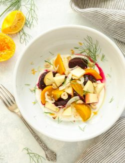 overhead shot of beet and apple salad with fork alongside