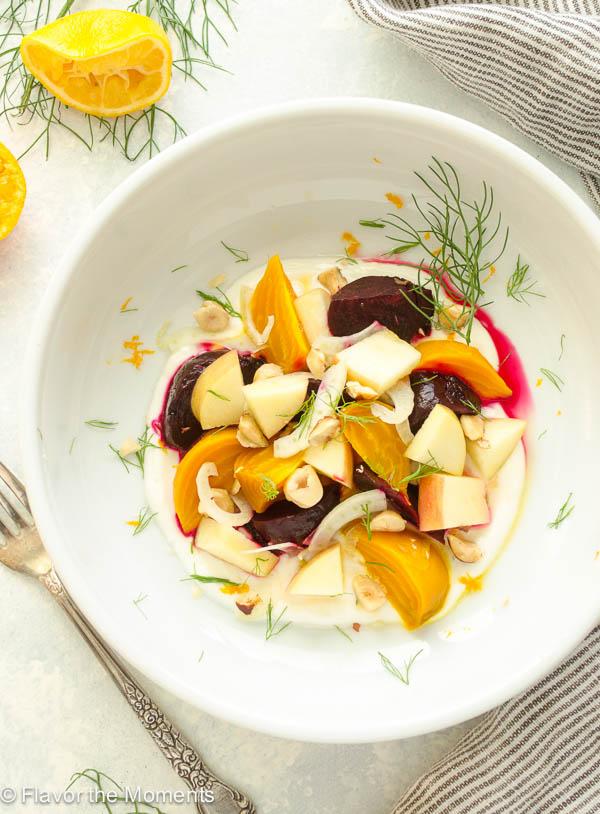 close up overhead shot of beet apple salad in citrus honey yogurt