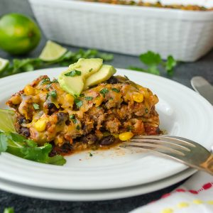 serving of tortilla casserole with avocado and cilantro on top