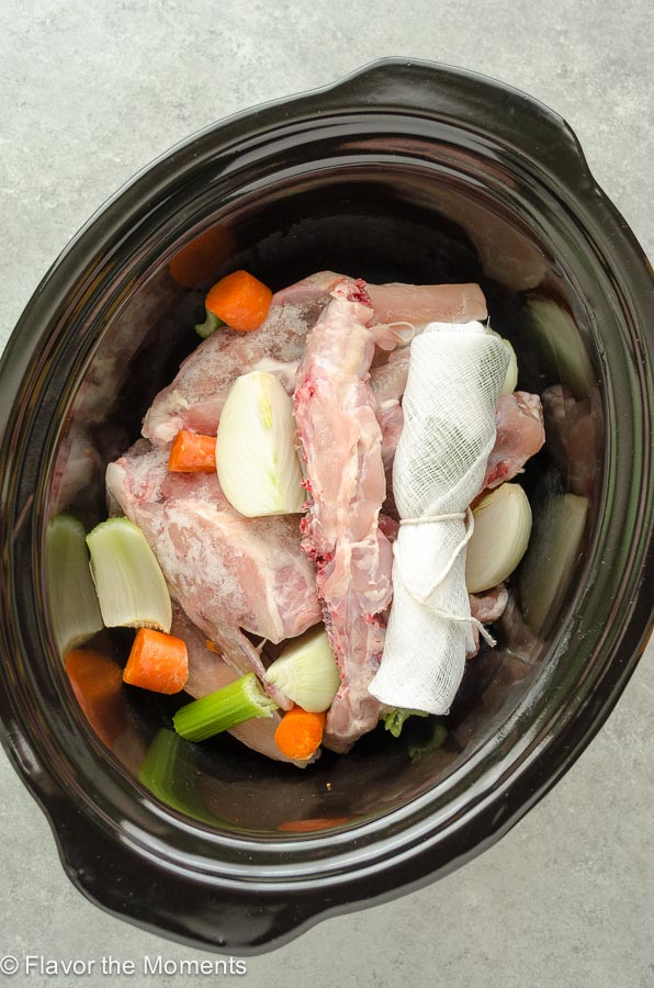 chicken stock ingredients in slow cooker before adding water
