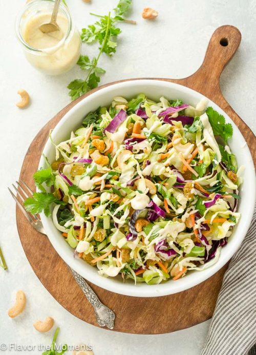 Coleslaw with Creamy Curry Dressing is crunchy cabbage blend tossed with an addicting creamy curry dressing. It's a delicious twist on classic coleslaw! (GF, V) @FlavortheMoments