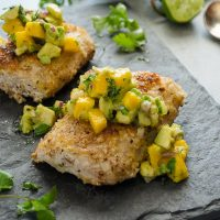 macadamia crusted mahi mahi with mango avocado salsa on top