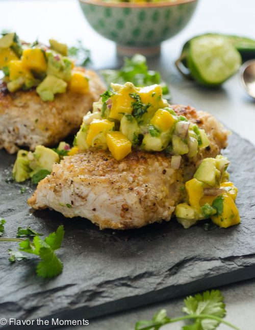 Macadamia Crusted Mahi Mahi with Mango Avocado Salsa is an easy family-friendly meal that's on the table in 30 minutes! @FlavortheMoment