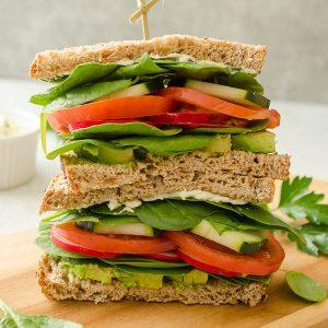 veggie sandwich on a cutting board
