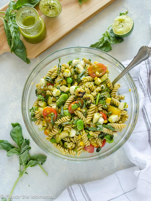 summer succotash pasta salad in glass bowl