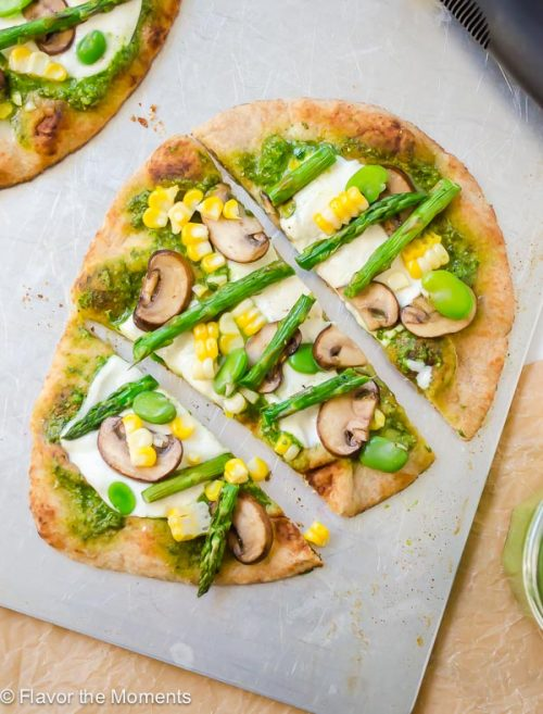 Grilled Veggie Flatbread Pizza with Pesto is whole grain naan topped with pesto, fresh mozzarella, and plenty of veggies. It's an easy, delicious healthy pizza option! @FlavortheMoment