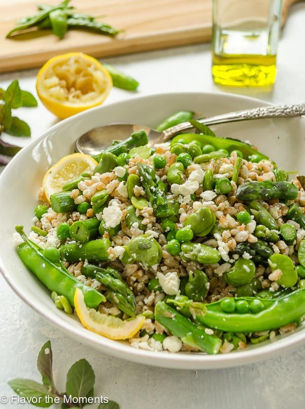Spring Farro Salad in a white bowl with lemon