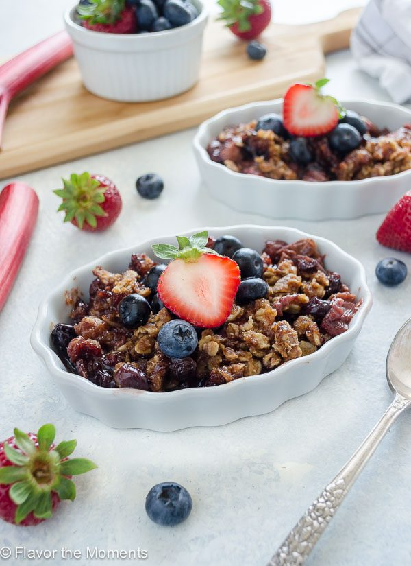 Slow Cooker Mixed Berry Rhubarb Crisp is the best way to enjoy fruit crisp without turning on the oven! It's a vegan dessert with no refined sugar or butter, and there's a recipe video to make the preparation even easier! @FlavortheMoment