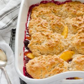 Fresh Peach Blackberry Cobbler is a delicious blend of juicy peaches and sweet blackberries topped with a tender, golden buttermilk biscuit topping! @FlavortheMoment