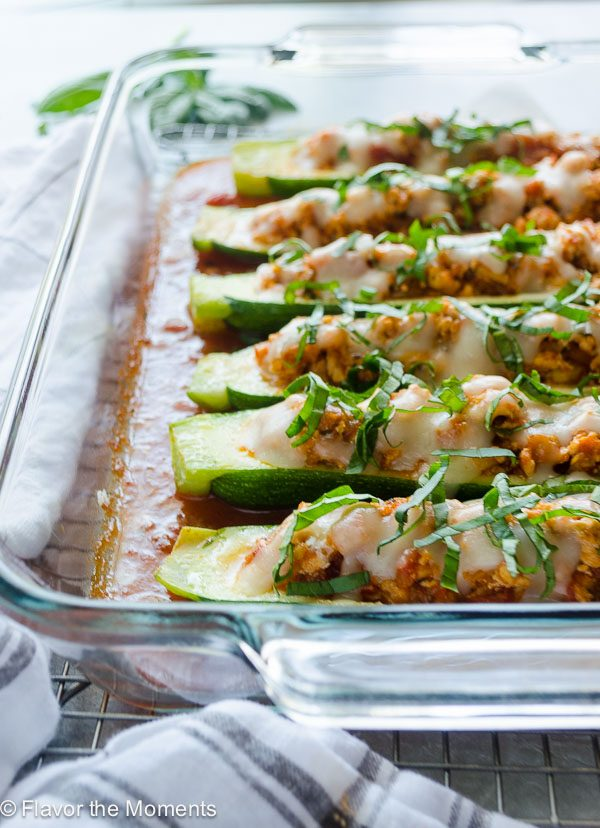 Chicken Parmesan Stuffed Zucchini Boats lined up in a baking dish