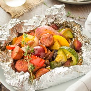 Sausage foil packets with peppers and zucchini